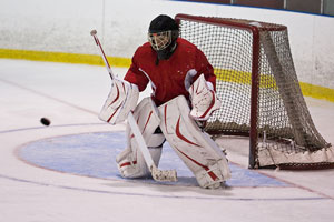 ice hockey goalie making a save