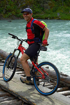 mountain biker on wooden bridge
